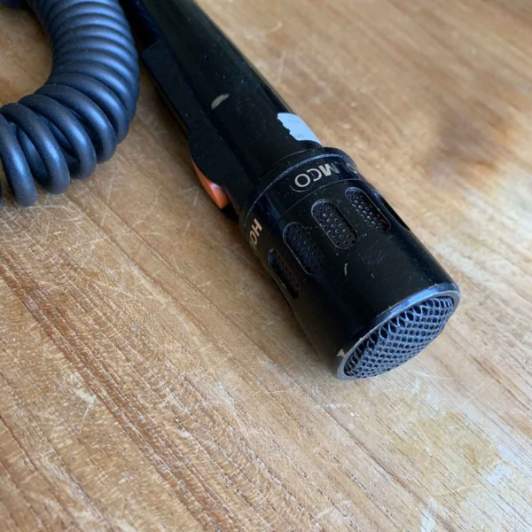 Detail of a Holmco handheld microphone that has been used in a Brussels Airlines Airbus A319 OO-SSC.